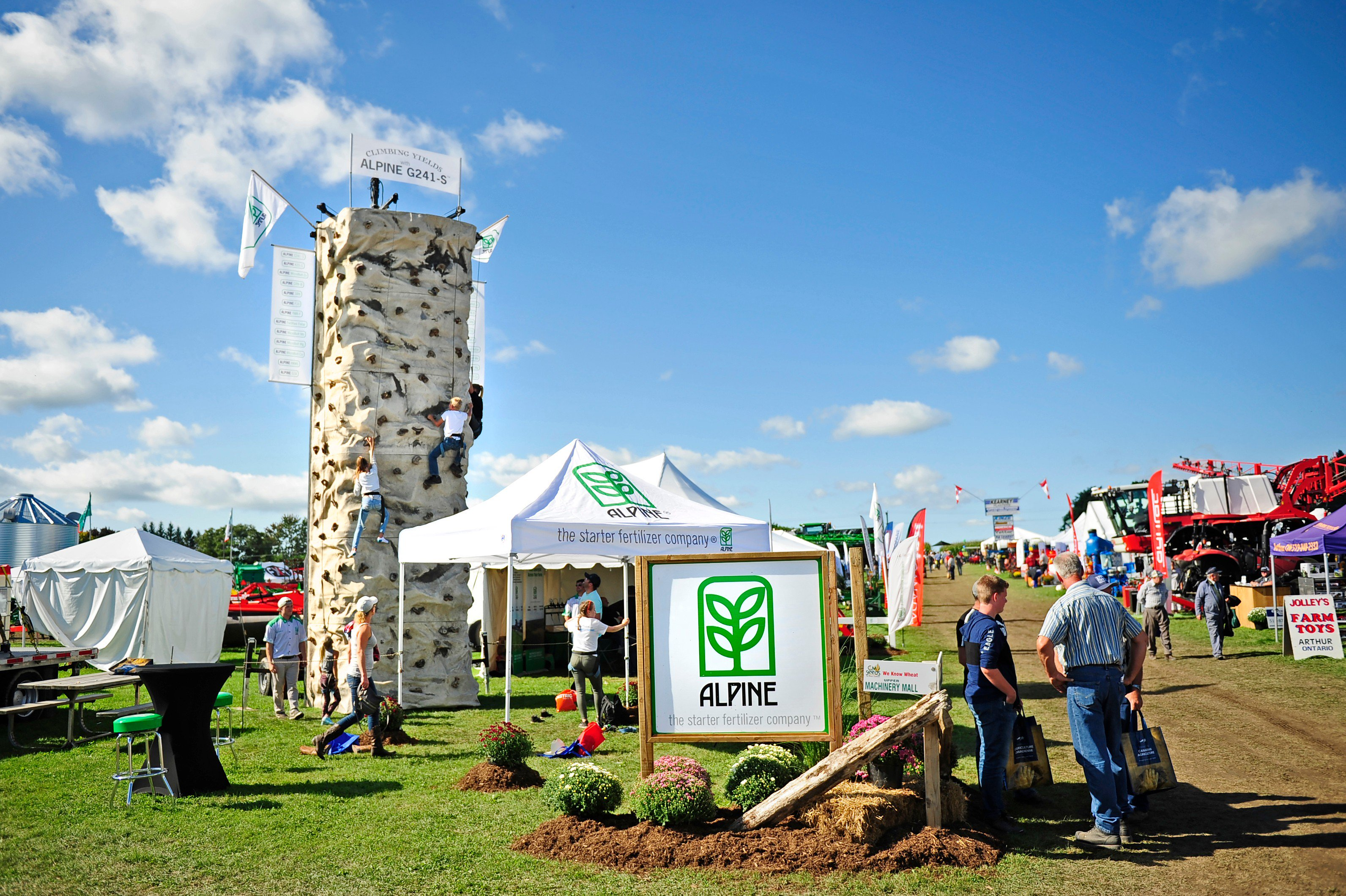 Outdoor festival with tents and climbing wall